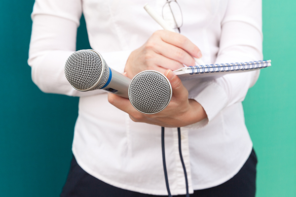 Professional Publicist and marketer taking notes with microphones