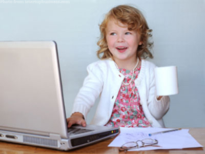 Child at laptop with coffee cup