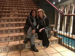Jeanne Sullivan and Margot Black taking a quick break at a hotel event